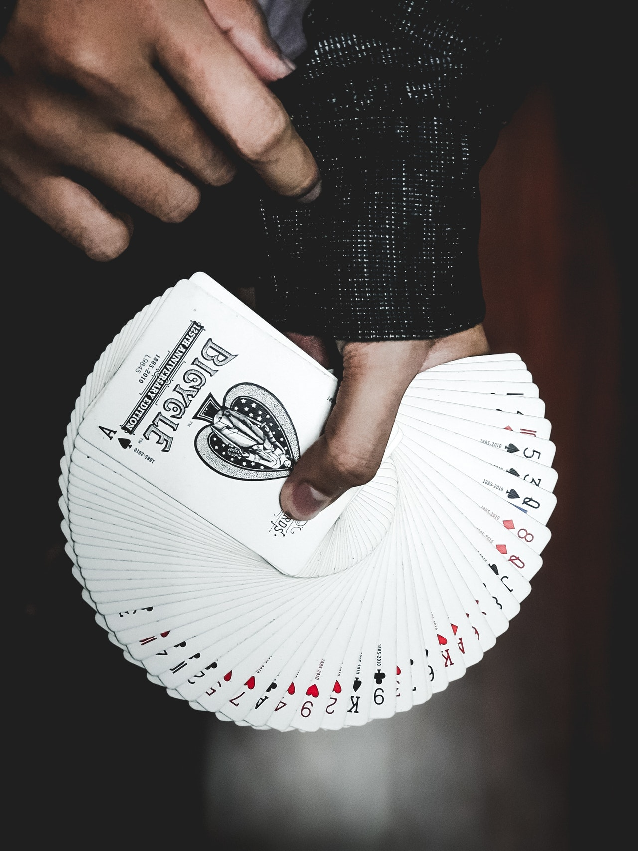 deck of cards in the hand